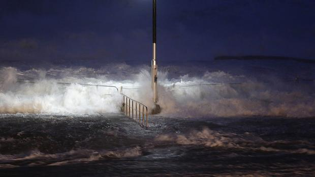 Huge waves crash over swimming baths at Avalon Beach in Sydney. (AP)