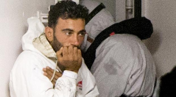 Traumatised shipwreck survivor Mohammed Ali Malek waits to disembark from Italian coastguard ship Bruno Gregoretti at Catania (AP)