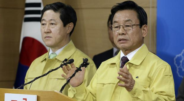 Public safety and security minister Park In-yong, right, and oceans and fisheries minister Yoo Ki-june reveal plans to salvage the Sewol (AP)