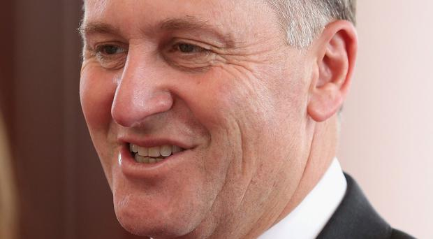 New Zealand's prime minister John Key has apologised for repeatedly pulling a cafe worker's ponytail