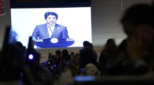Japanese Prime Minister Shinzo Abe delivers his speech at the Asian African Summit in Jakarta, Indonesia. (AP)