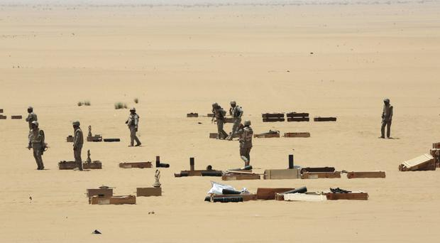 Saudi soldiers prepare to fire artillery towards the border with Yemen in Najran, Saudi Arabia. (AP)