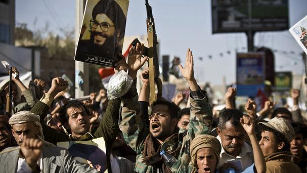 Iran-backed Houthi rebels, holding a poster of Hezbollah leader Sheikh Hassan Nasrallah, protest in Sanaa, Yemen, against Saudi aggression (AP)