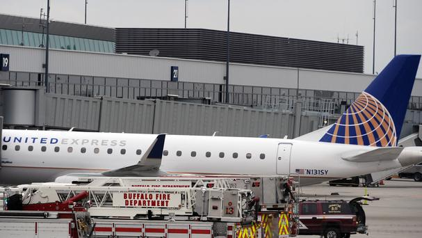 Emergency vehicles surround the jet after its emergency landing at Buffalo Niagara International Airport (AP)