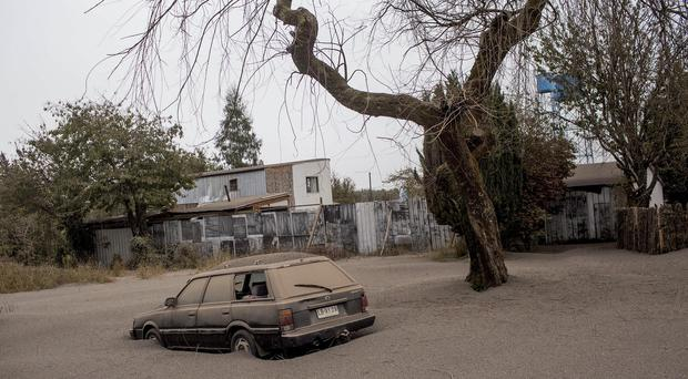 A car is covered in ash left behind by the eruptions of the Calbuco volcano in Ensenada (AP)