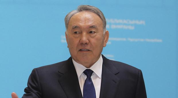Kazakhstan's President Nursultan Nazarbayev casts his vote polling station in Astana, the capital of Kazakhstan (AP)