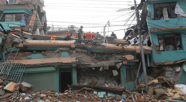 Rescue teams working in the collapsed Sitapyla church in Kathmandu (AP)