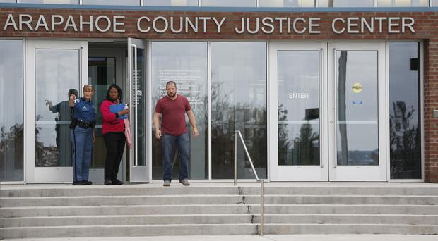 People leave the courthouse at the conclusion of the opening day of the trial (AP)