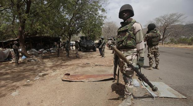 Nigerian Soldiers man a check point in Gwoza, Nigeria, a town newly liberated from Boko Haram (AP)