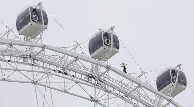 Daredevil performer Nik Wallenda walks untethered along the rim of the Orlando Eye (AP)