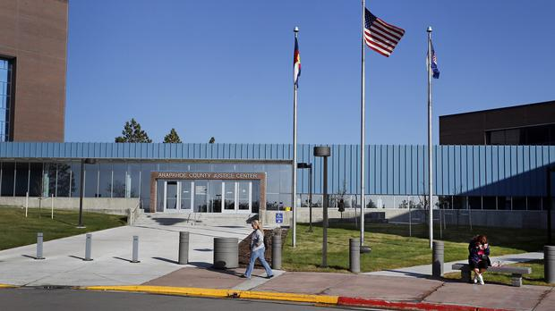 A US flag waves outside the Arapahoe County Justice Centre where the trial of James Holmes is being held (AP)