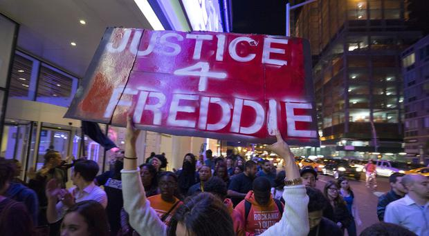 Protesters on the west side of Manhattan in New York as people gathered in several areas to protest over the death of Freddie Gray, a Baltimore man who was critically injured in police custody (AP)