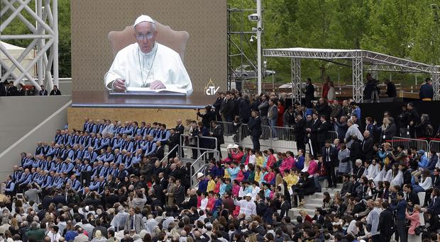 Pope Francis' message is broadcast during the opening ceremony of the Expo 2015 fair in Milan. (AP)