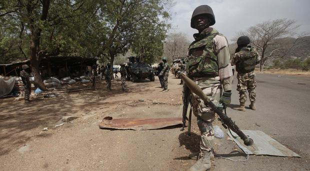 Nigerian soldiers man a checkpoint in Gwoza, a town newly liberated from Boko Haram (AP)