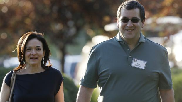 Sheryl Sandberg, COO of Facebook, with her husband David Goldberg, who has died aged 47 (AP)