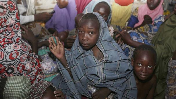 Women and children rescued by Nigerian soldiers from Boko Haram extremists arrive at a refugee camp (AP)