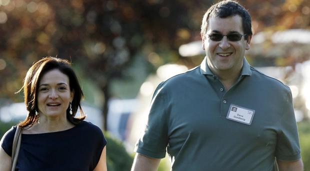 David Goldberg, pictured with his wife Sheryl Sandberg, apparently slipped while on a gym treadmill (AP)