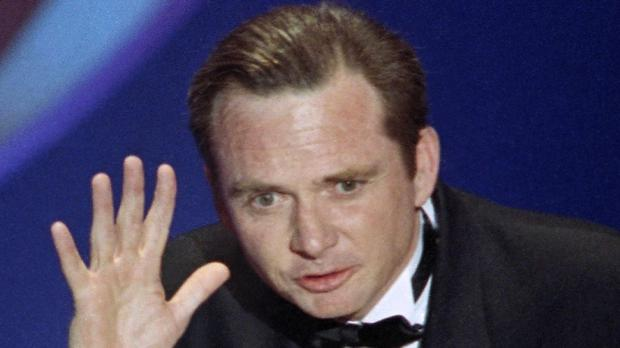 Michael Blake accepts his best adapted screenplay Oscar for Dances With Wolves in 1991 (AP)