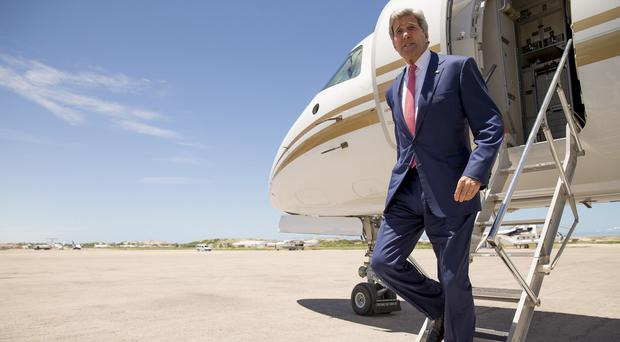 US Secretary of State John Kerry arrives at the airport in Mogadishu, Somalia (AP)
