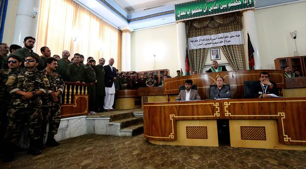The opening of the trial at Afghanistan's Primary Court was broadcast live on nationwide television. (AP)