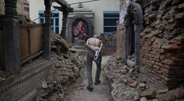 A huge team of inspectors are checking the safely of buildings across Kathmandu following the earthquake (AP)