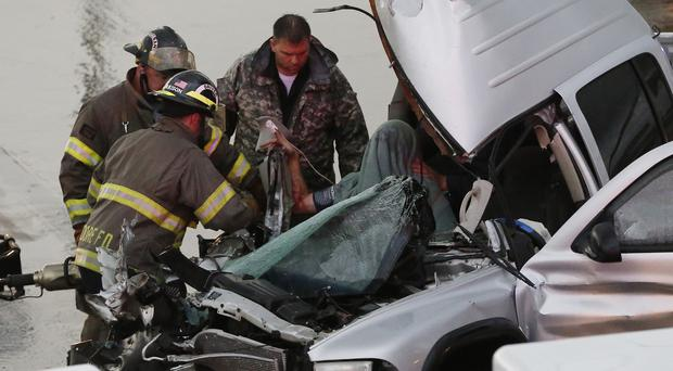 Emergency crews work to free a passenger from a truck involved in an accident in Moore, Oklahoma (AP)
