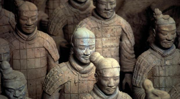 The ancient army of Terracotta Warriors which keeps a symbolic guard over the tomb of the first Qin emperor