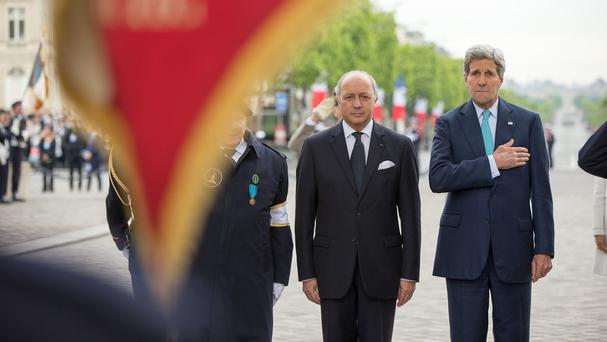 US secretary of state John Kerry, right, with French foreign minister Laurent Fabius at the Tomb of the Unknown Soldier in Paris. (AP)
