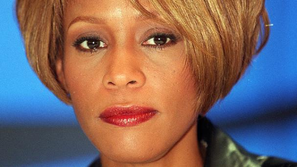 The late Whitney Houston on a visit to London