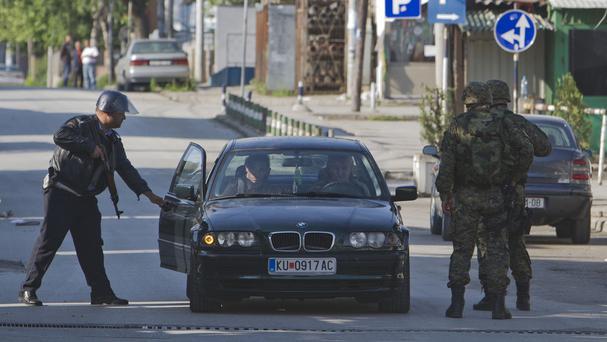 Macedonian special forces stop a vehicle amid clashes involving the police and an armed group (AP)