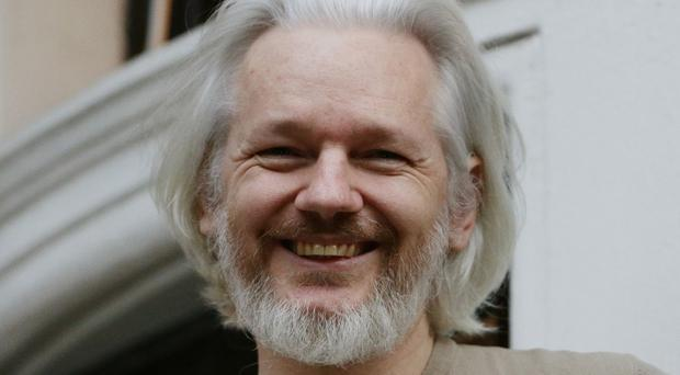 Julian Assange on the balcony of the Ecuadorian Embassy in London
