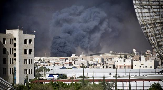 Smoke rises after a Saudi-led air strike hit a site believed to be a munitions storage in Sanaa. (AP)