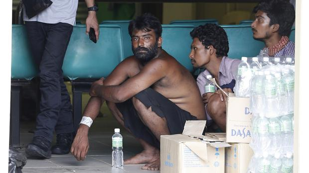 Migrants wait at a temporary immigration detention centre in Langkawi, Malaysia. (AP)