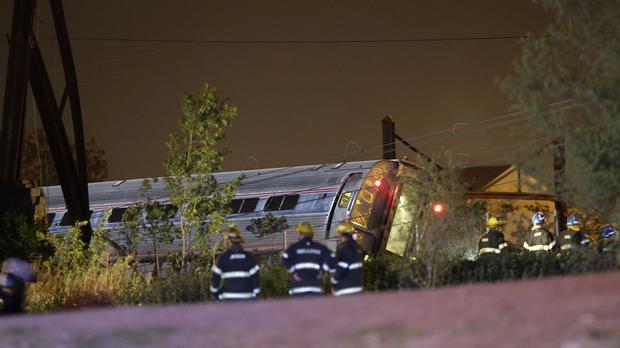 Emergency personel work at the scene of a train crash in Philadelphia (AP)