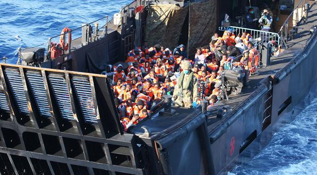 A landing craft transporting migrants back to HMS Bulwark after their rescue in the Mediterranean Sea.