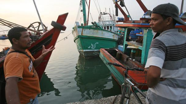 The boat used to carry Rohingya Muslims from Burma and migrants from Bangladesh is docked at a port in Lhokseumawe (AP)