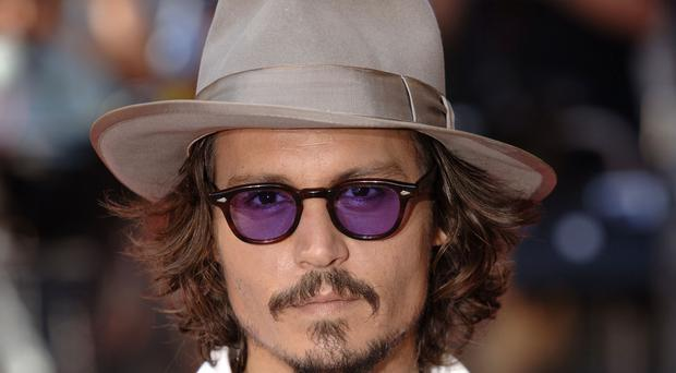 Johnny Depp returned to Australia to resume filming of the fifth instalment in the Pirates of the Caribbean series