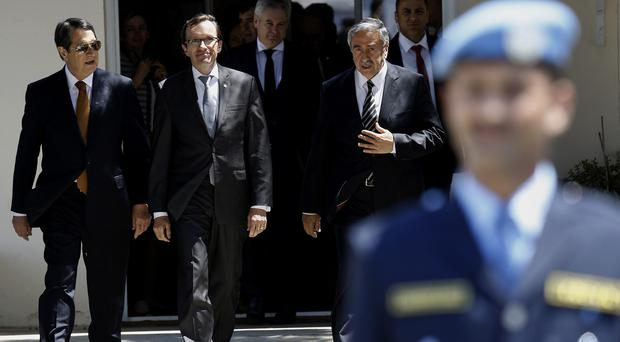 Cyprus president Nicos Anastasiades and Turkish Cypriot leader Mustafa Akinci flank UN envoy Espen Barth Eide after talks. (AP)