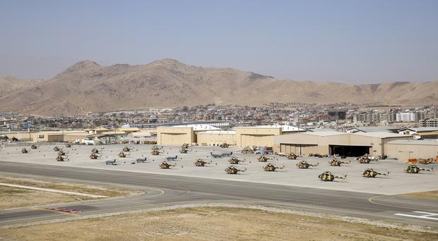 A suicide bomber struck at the major checkpoint leading into Kabul airport