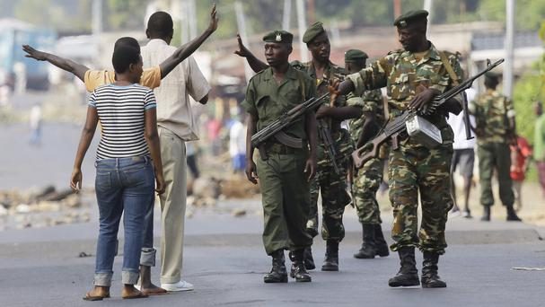 Protesters argue with soldiers after being dispersed in the Musage neighbourhood of Bujumbura, Burundi (AP)