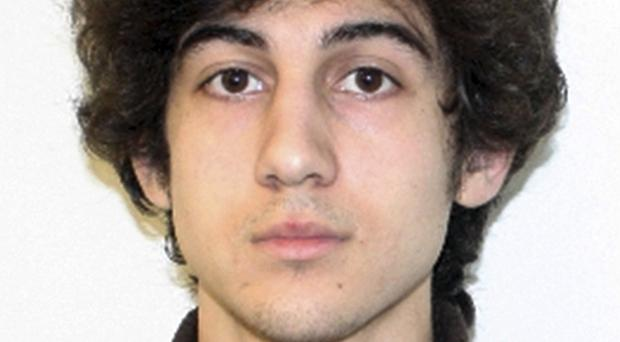 Dzhokhar Tsarnaev's Boston trial venue and evidence from victims of the marathon bombing are expected to form the grounds of his appeal against his death sentence (FBI/AP)