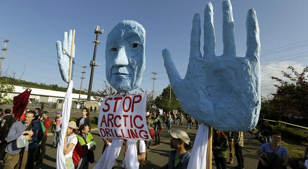 Protesters opposed to Arctic oil drilling rally at the Port of Seattle (AP)