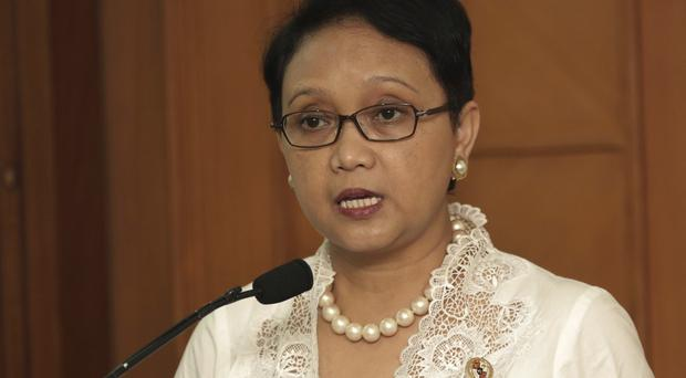 Foreign minister Retno Marsudi says Indonesia has 'given more than it should' to help migrants stranded on boats by human traffickers (AP)