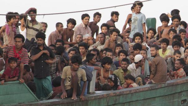 Migrants wait to be rescued as Indonesia and Malaysia offered to provide temporary shelter to thousands. (AP)