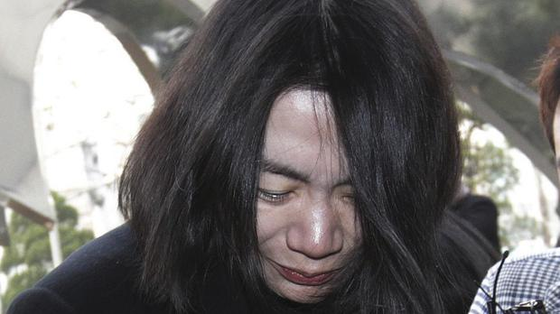 Cho Hyun-ah pictured after her nut rage arrest (AP)