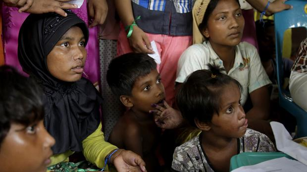 Ethnic Rohingya gather to receive medical treatments at a temporary shelter in Indonesia. (AP)