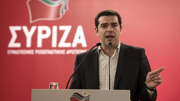 Greek PM Alexis Tsipras addresses the audience during a Syriza party meeting in Athens (AP)