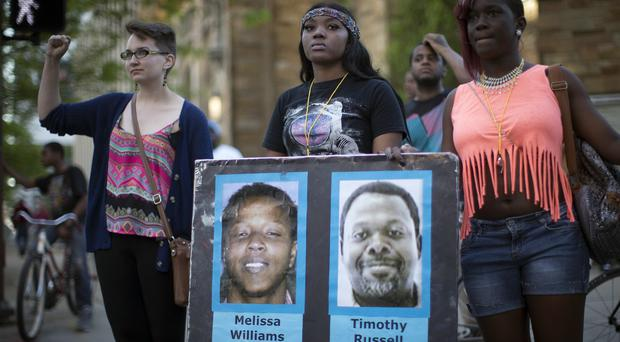 Demonstrators protest against the acquittal of policeman Michael Brelo over the fatal shooting of two unarmed suspects (AP)