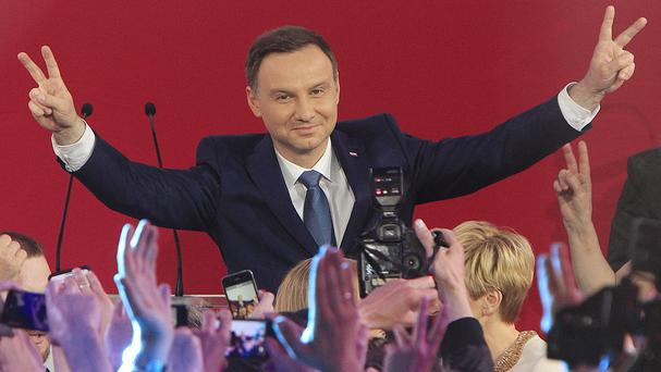 Opposition candidate Andrzej Duda celebrates with supporters (AP)