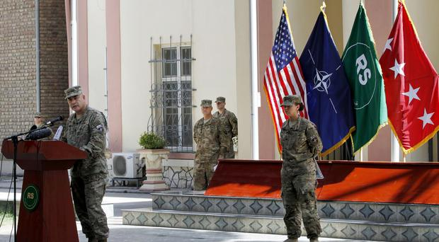 General John F Campbell, commander of international forces in Afghanistan, speaks during a ceremony marking Memorial Day at the Resolute Support main headquarters in Kabul, (AP)